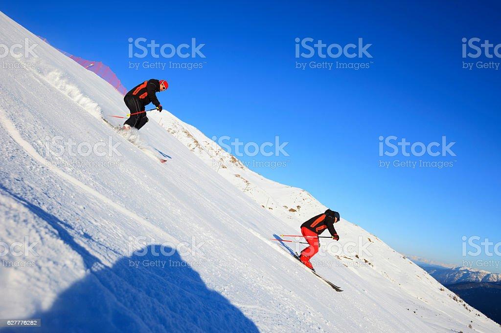 Two Men snow skier skiing   Enjoying on sunny ski resorts stock photo