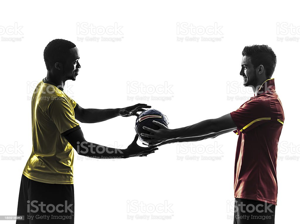two men soccer players giving football silhouette royalty-free stock photo