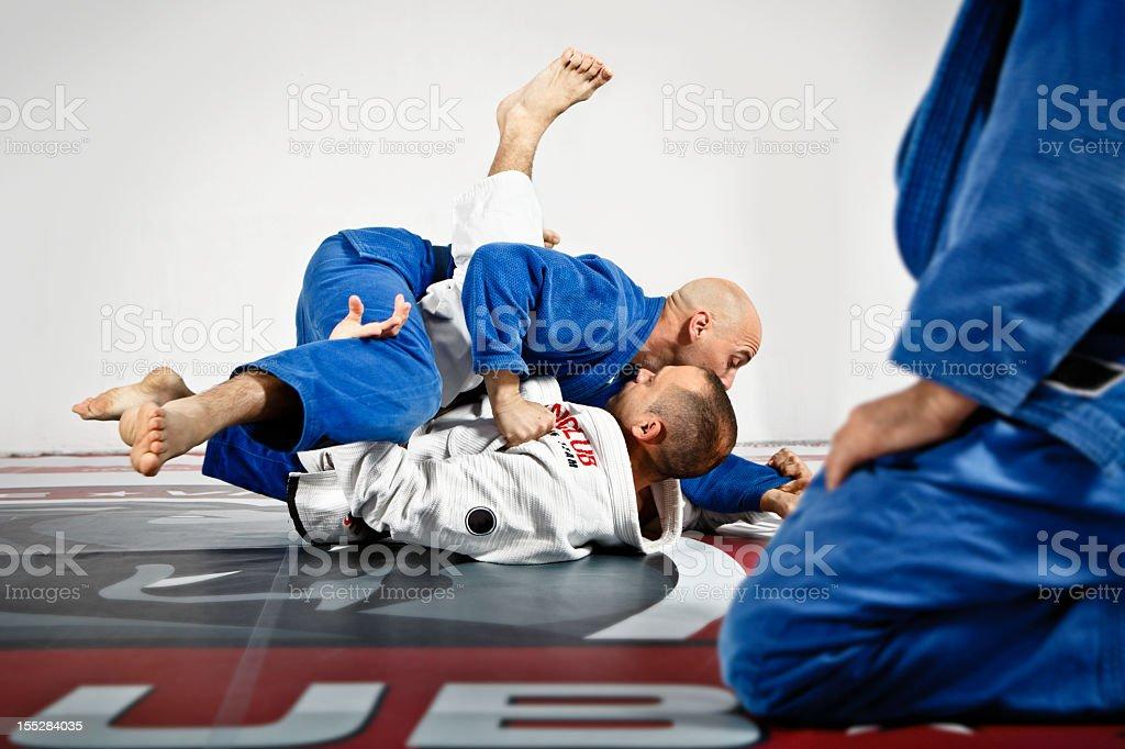 Two men sparring in Jiu-Jitsu training royalty-free stock photo