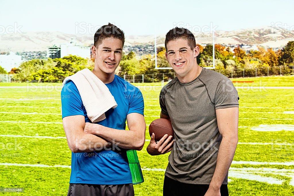 Two men standing in field stock photo
