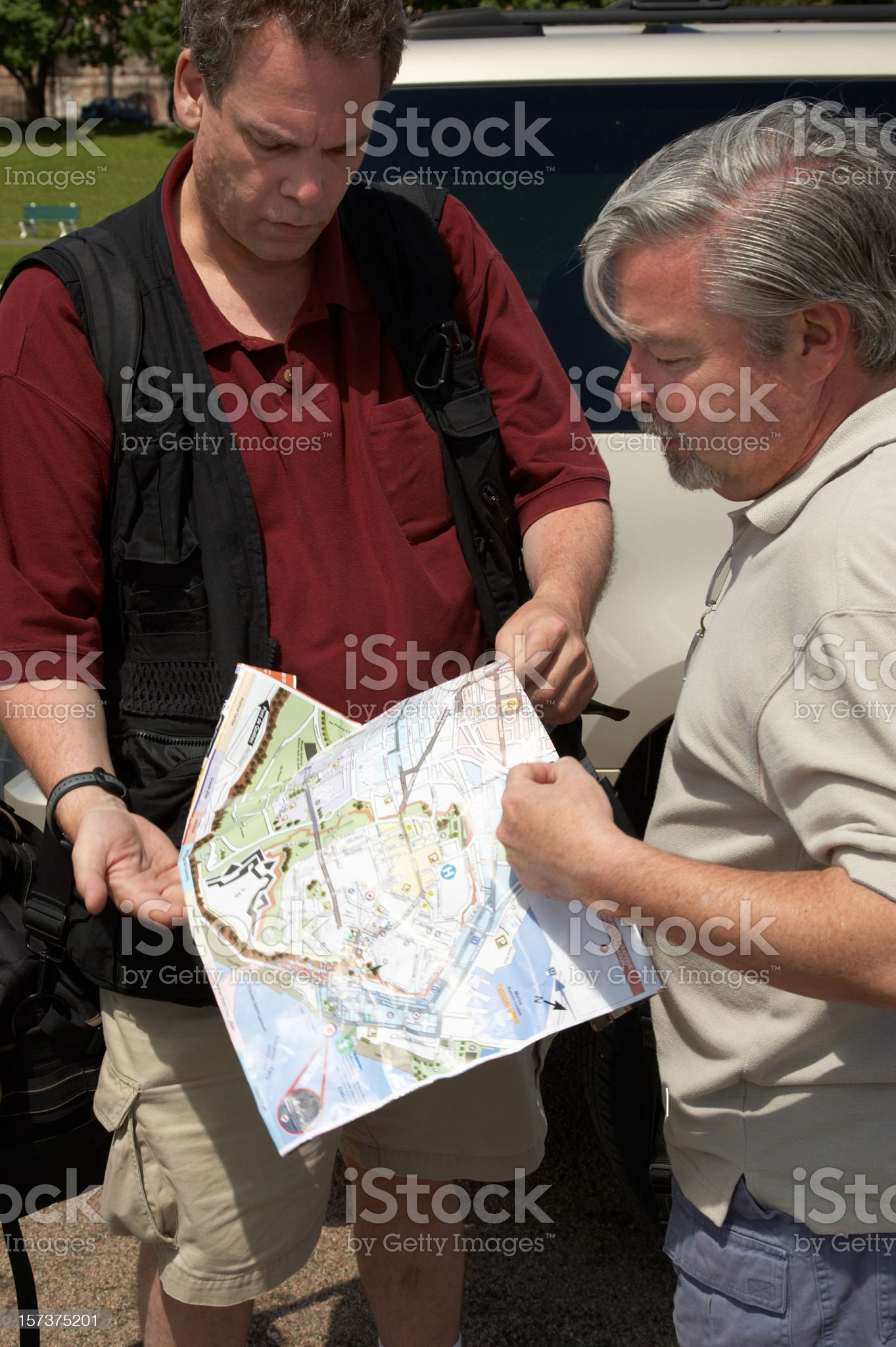 Two men studying map royalty-free stock photo