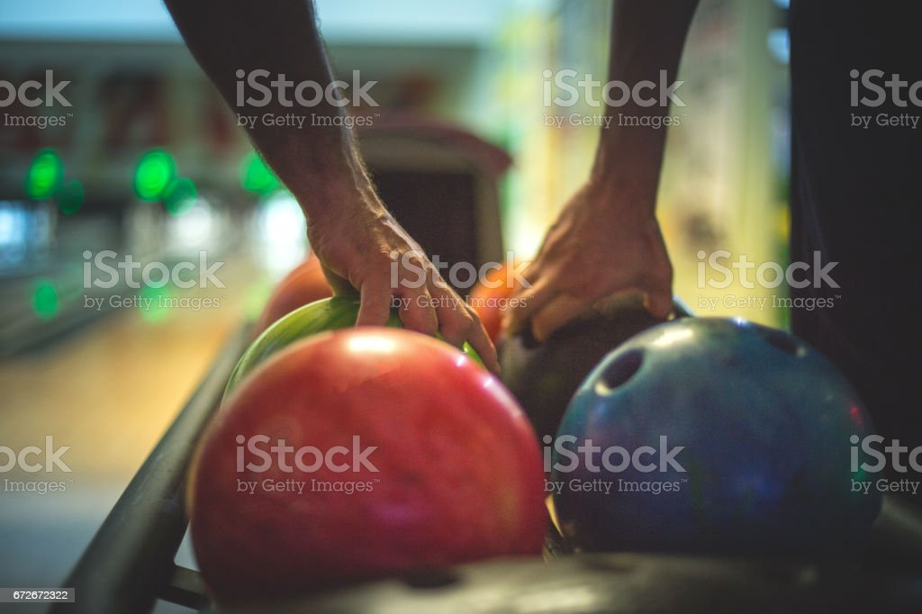 Two men taking balls to bowl stock photo
