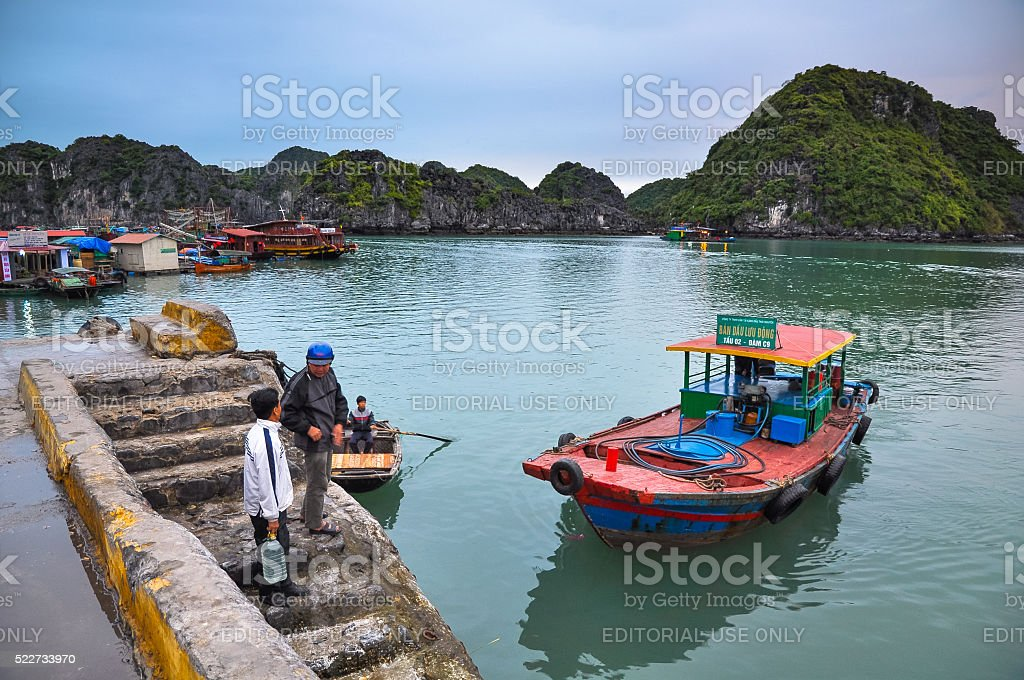 Two men talk on the docks of Cat Ba island stock photo