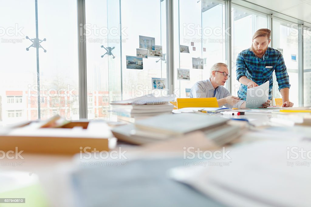 Two men talking about ideas in office planning studio stock photo
