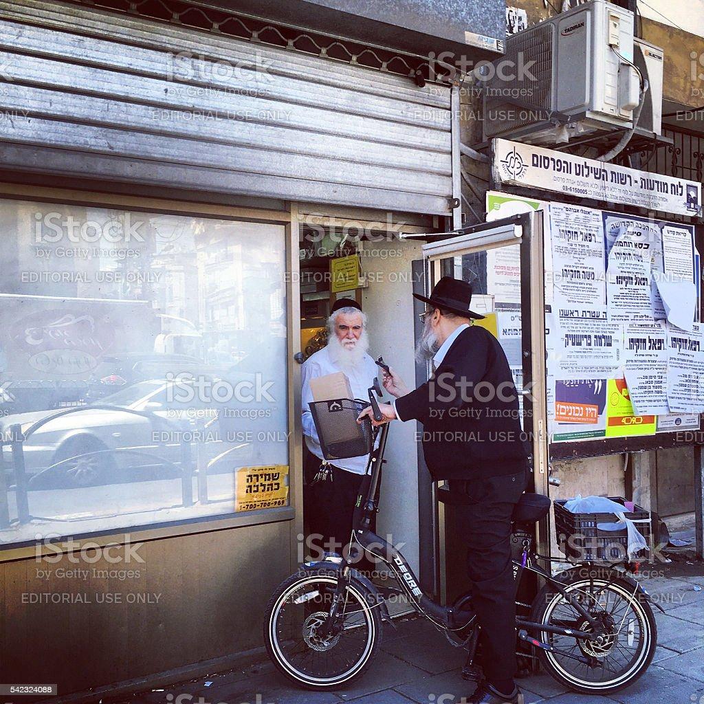 Two Men talking on Bnei Brak street, Israel stock photo
