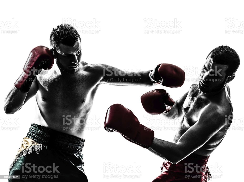 Two men Thai boxing, one punching stock photo