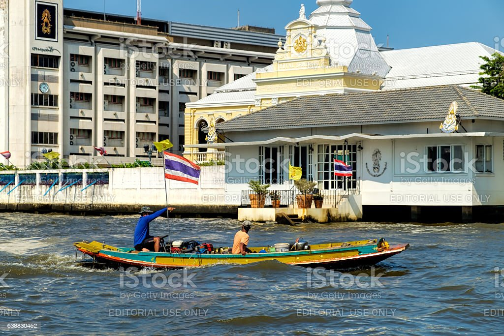 Two men travelling by boat in Chao Phraya river stock photo