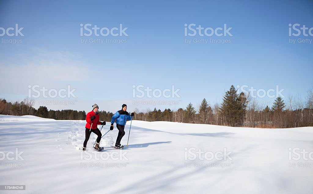 Two men trying skating in skiing place stock photo