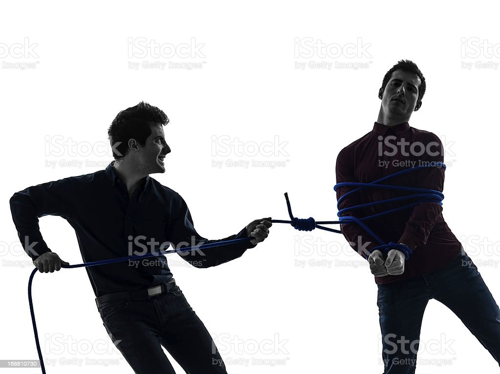 two  men twin brother friends conflict  silhouette royalty-free stock photo