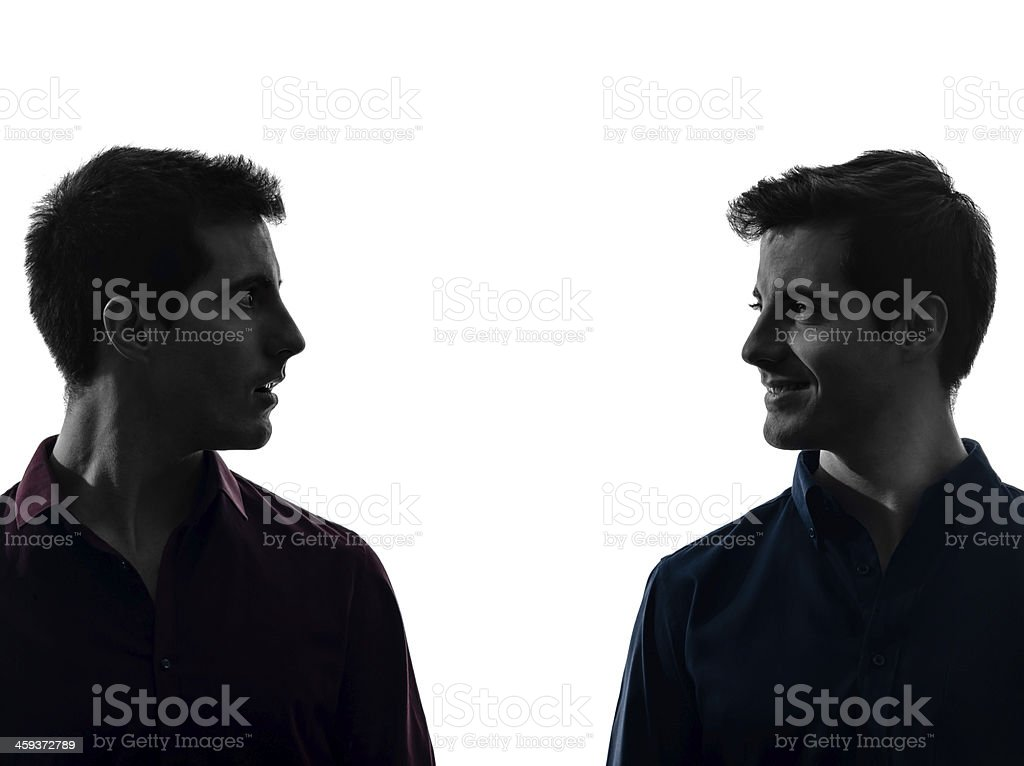 two men twin brother friends looking at each others silhouette stock photo