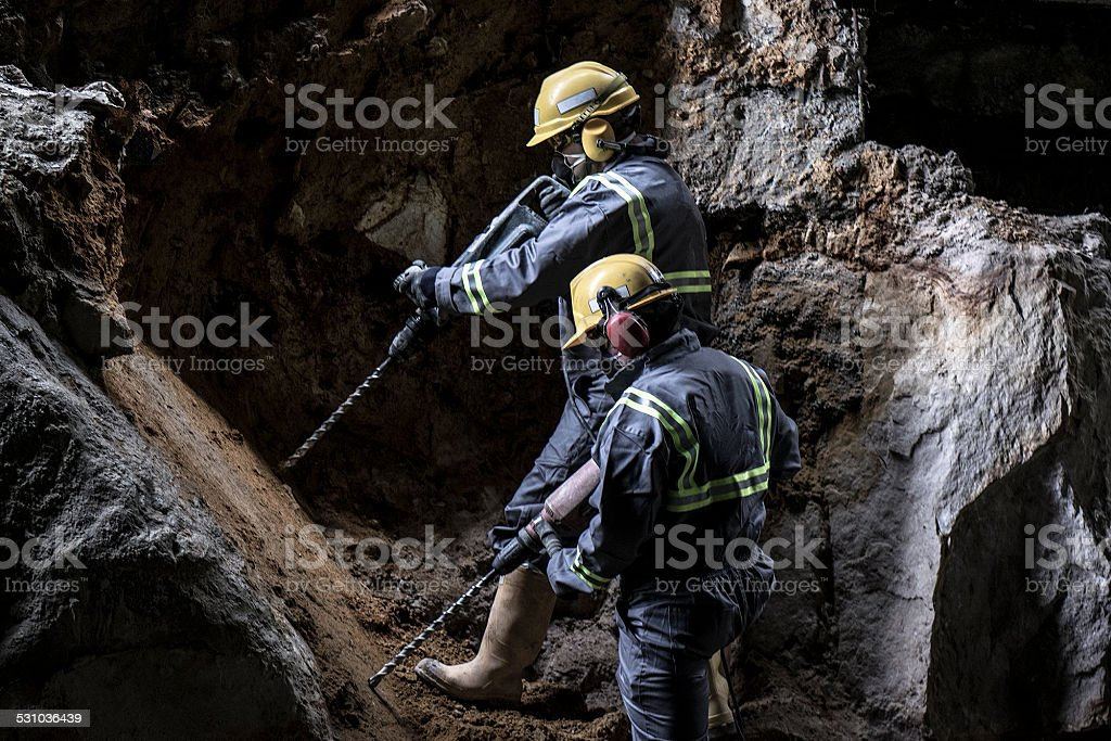 Two men, two drills stock photo