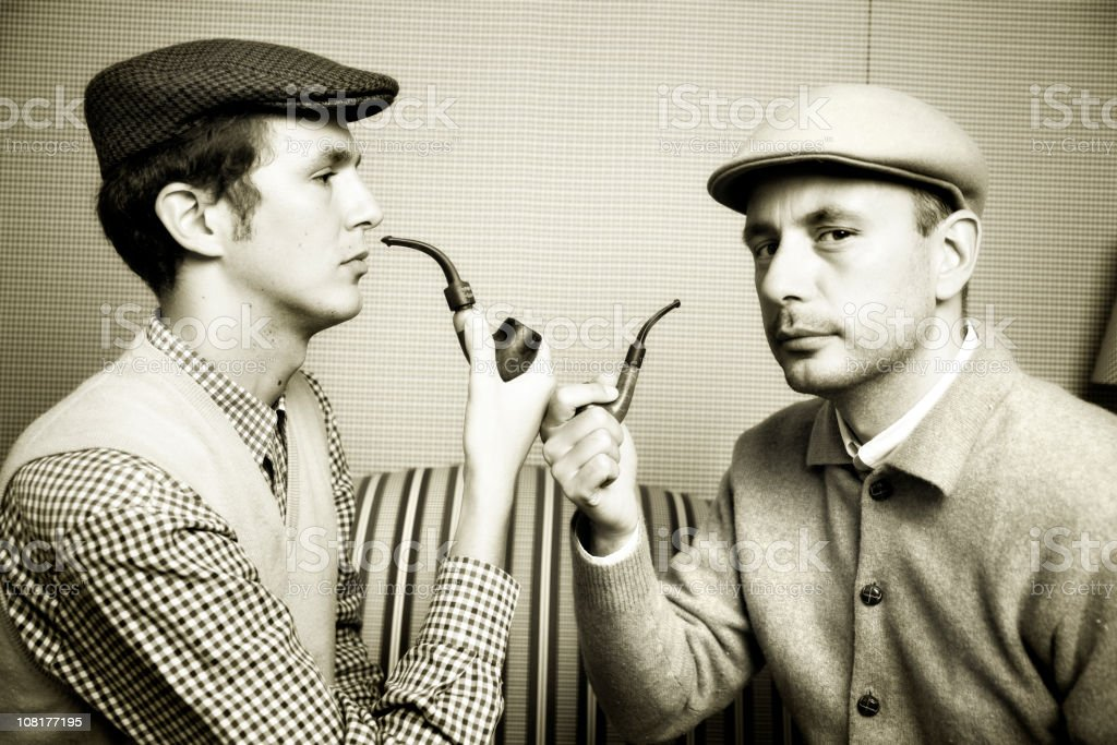 Two Men Wearing Newsboy Caps and Smoking Pipes royalty-free stock photo