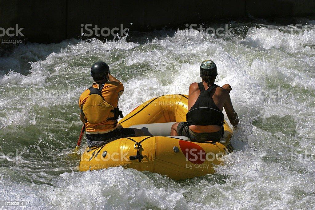 Two men white water rafting stock photo
