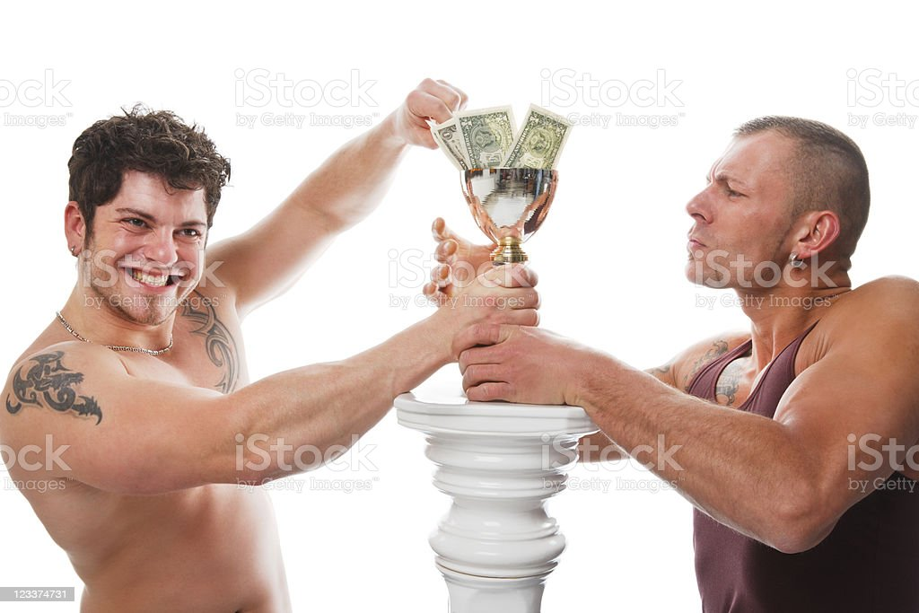 Two Men With A Trophy Full Of Dollars royalty-free stock photo