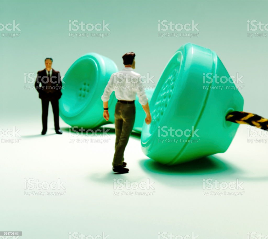 Two Men With Telephone Receiver stock photo