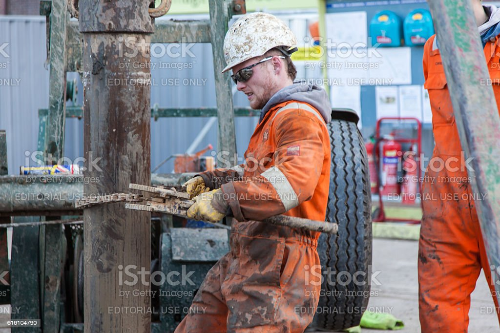 two men work on a drilling rig stock photo