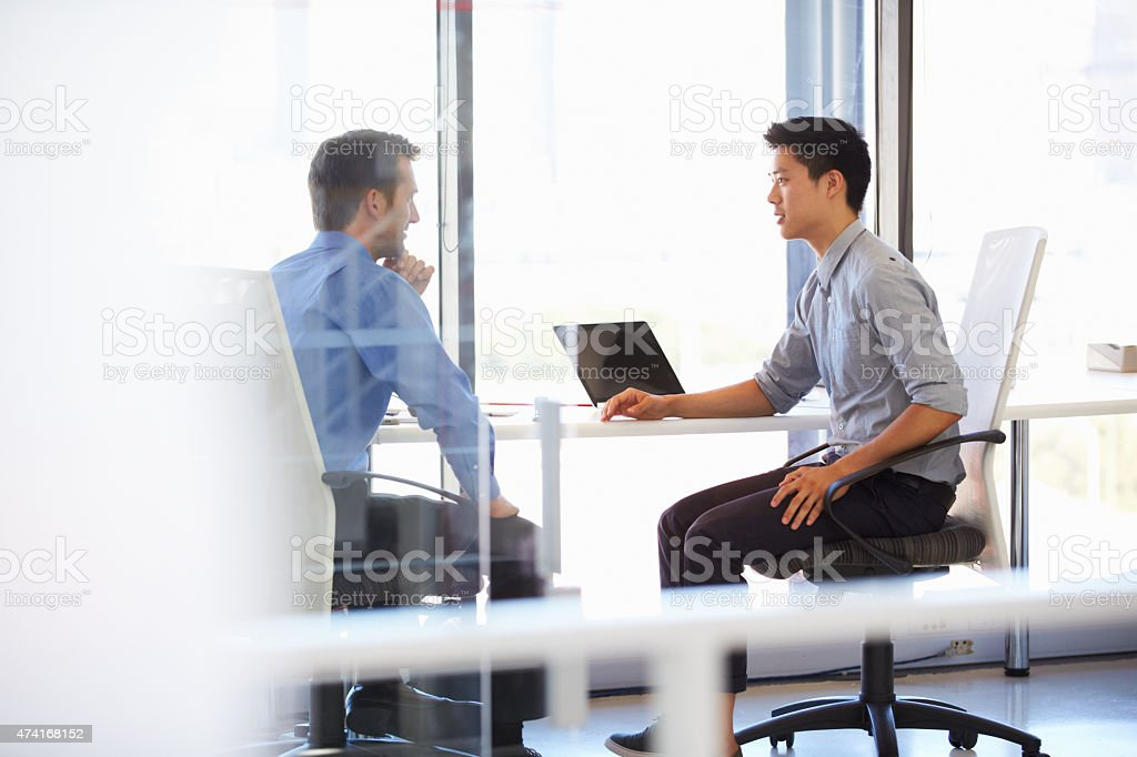 Two men working in a modern office stock photo