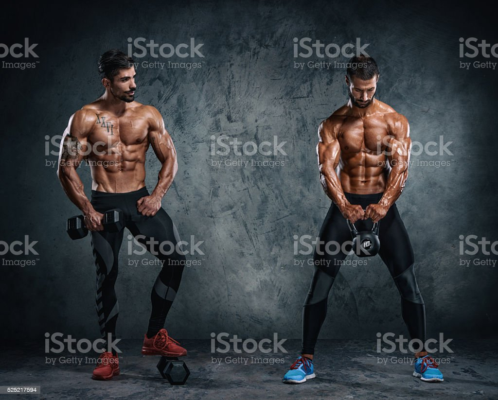 Two Men Working Out With Weights stock photo