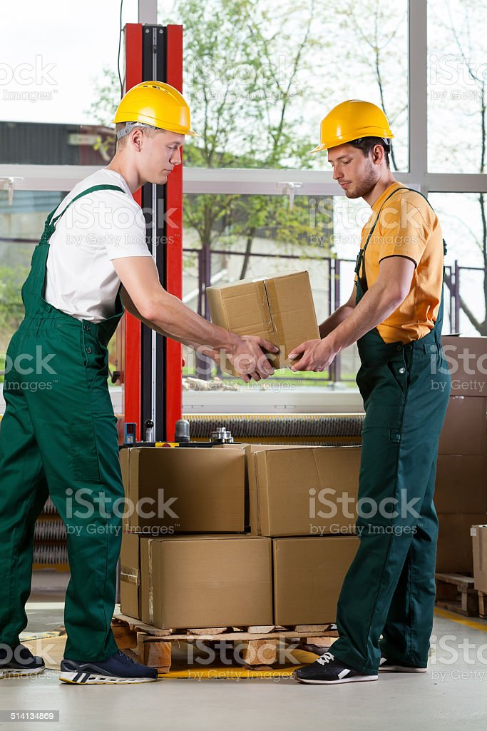 Two men working together at warehouse stock photo