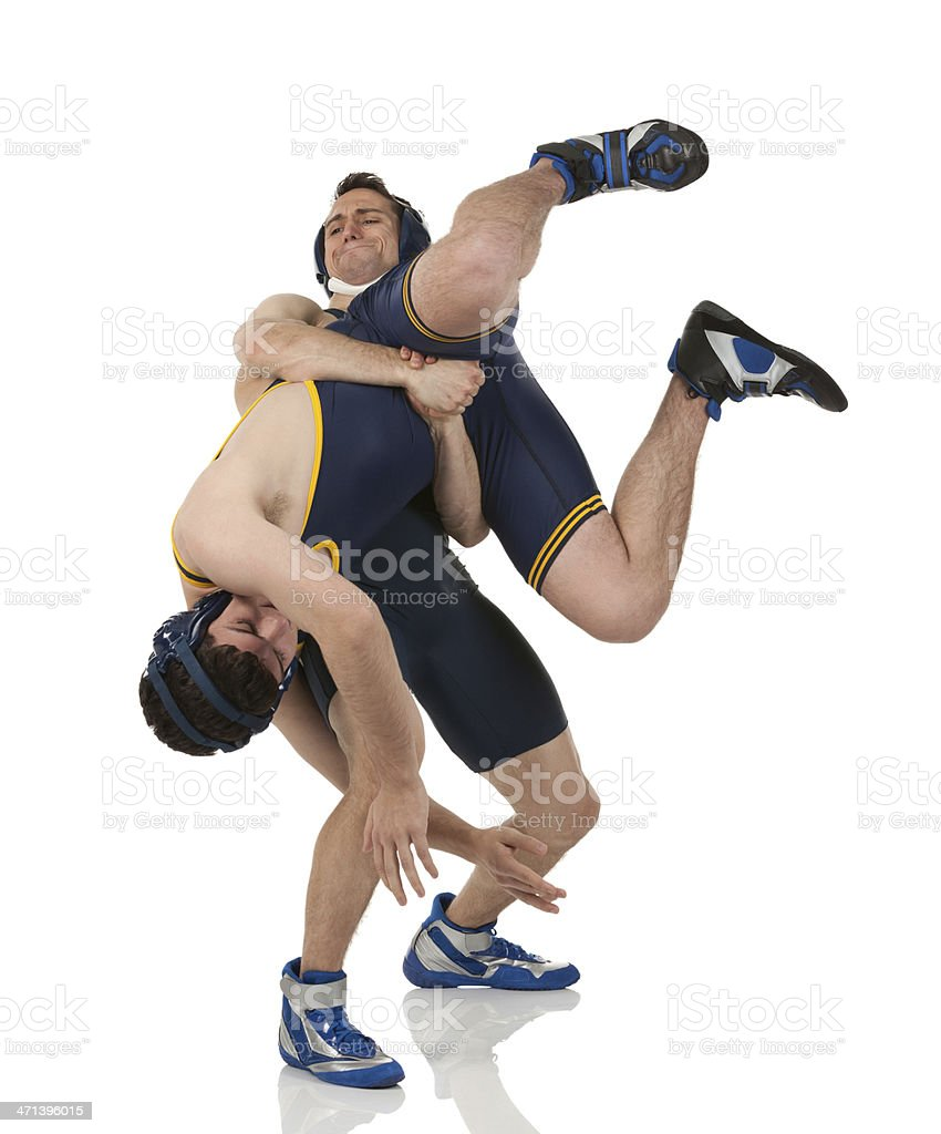 Two men wrestling stock photo