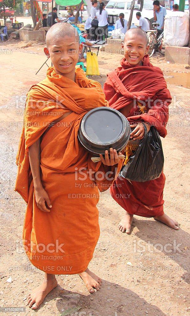 Two mendicant monchs stock photo