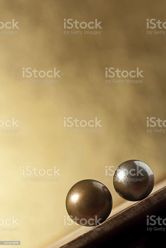 Two metal balls on sloping surface royalty-free stock photo
