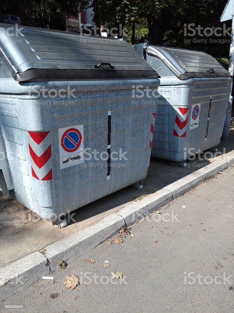 Two metal  containers for public garbage stock photo