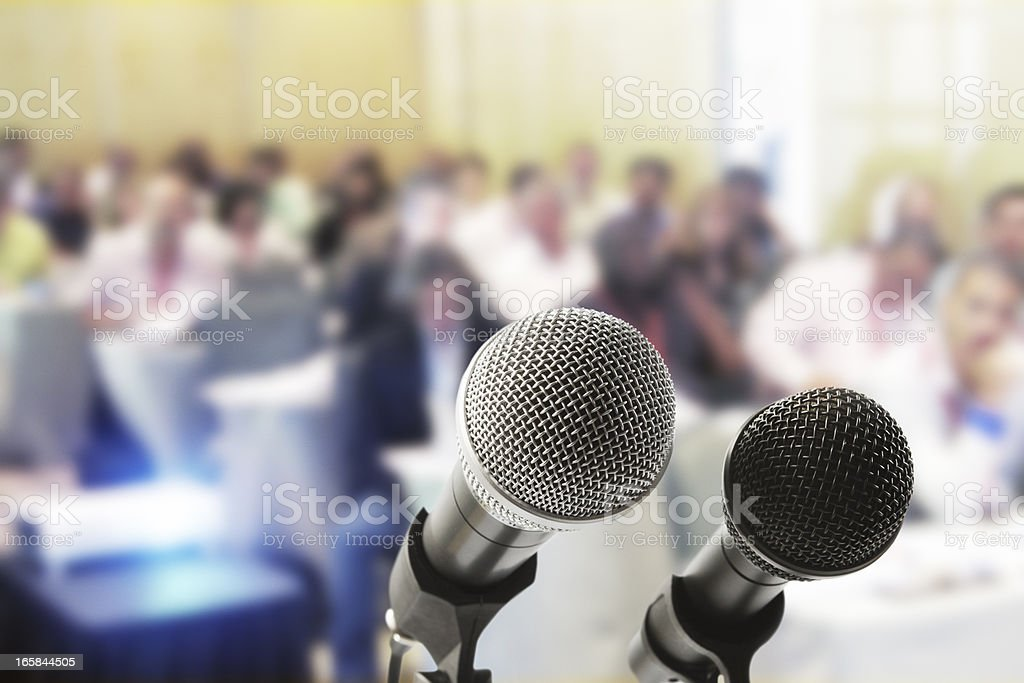 Two microphones wait for the speaker at a press conference royalty-free stock photo