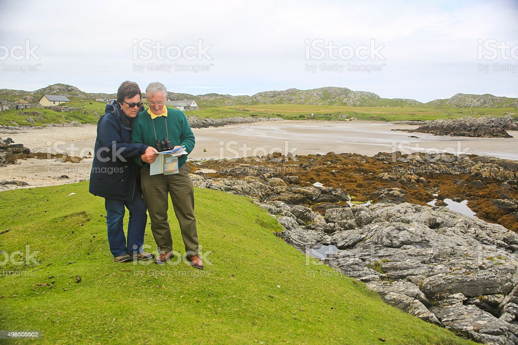 Two Middle Age Hikers Studying  Their Map stock photo