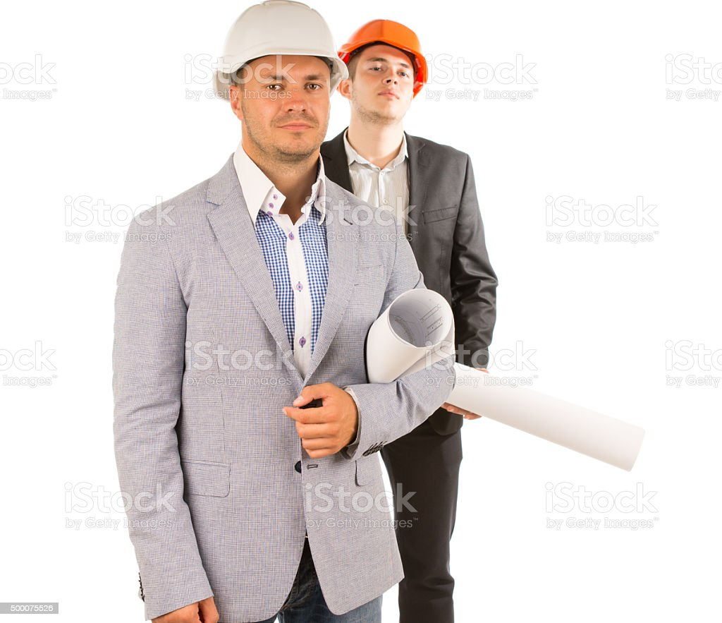 Two Middle Age Male Engineers Holding Blueprints stock photo