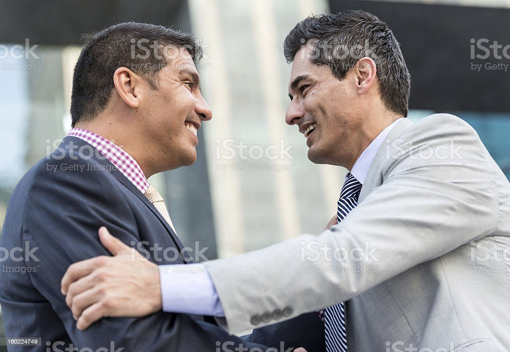 Two middle  aged business men greeting each other royalty-free stock photo