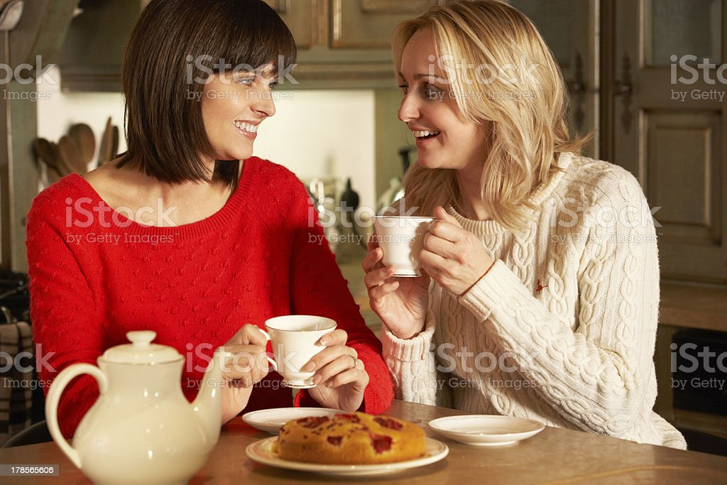 Two Middle Aged Women Enjoying Tea And Cake Together stock photo