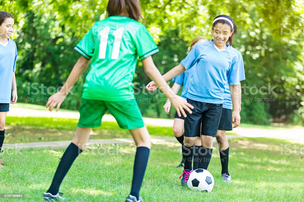 Two middle school girl soccer teams practicing together stock photo