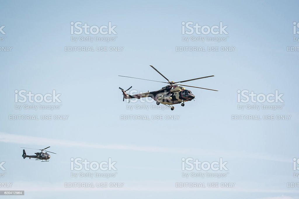 Two military helicopter on cloudy sky stock photo