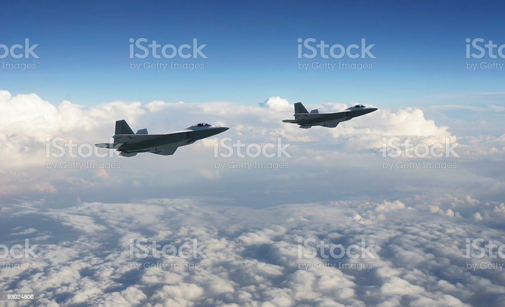 Two military jets above the clouds stock photo