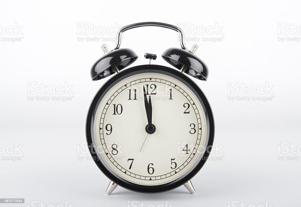 Two minutes to twelve o'clock. Alarm clock. stock photo