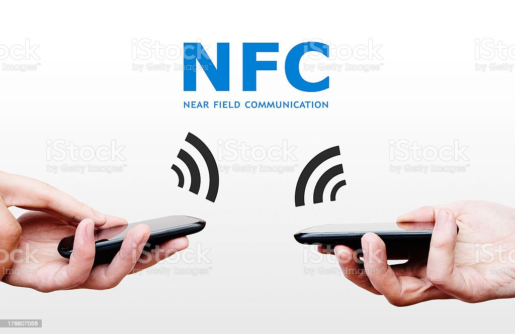 Two mobile phones with NFC payment technology. stock photo