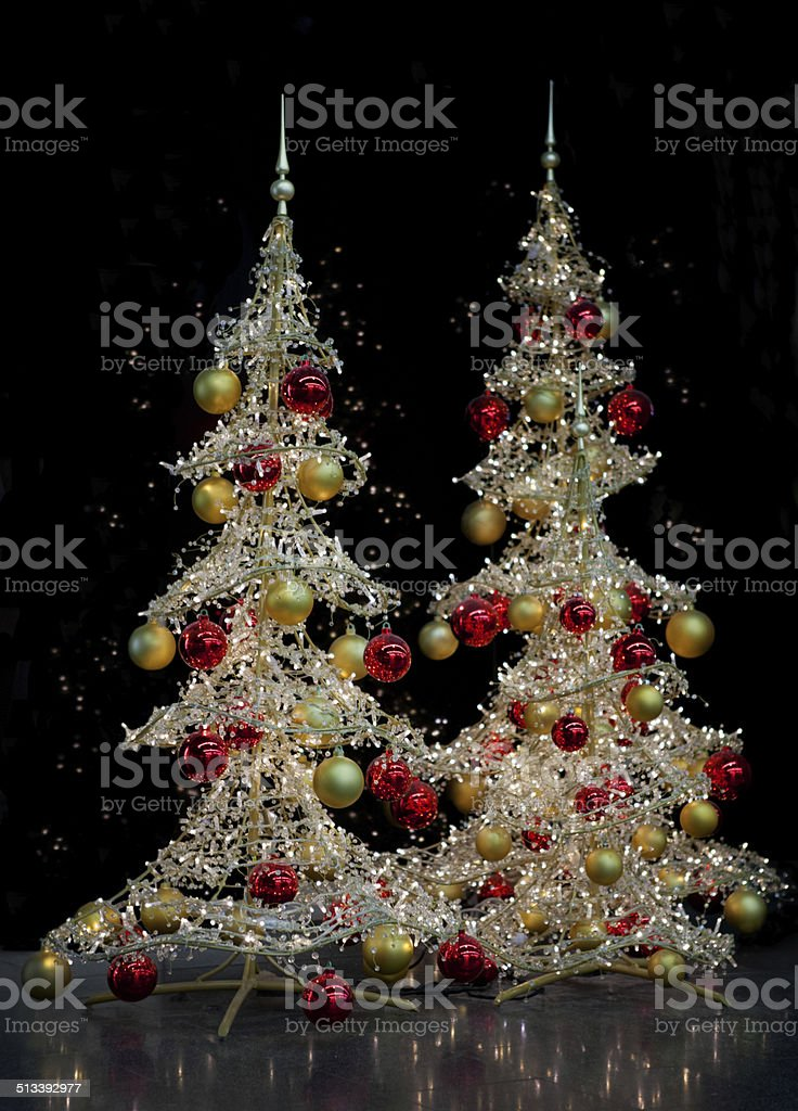 Two modern silver Christmas trees royalty-free stock photo