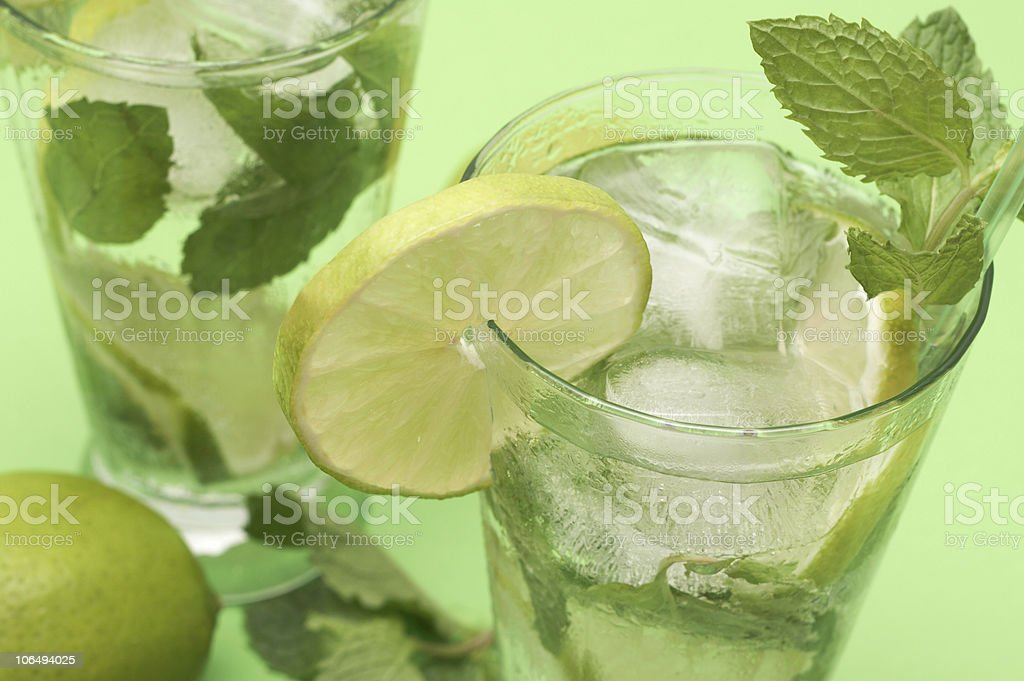 Two mojito cocktails on green background royalty-free stock photo