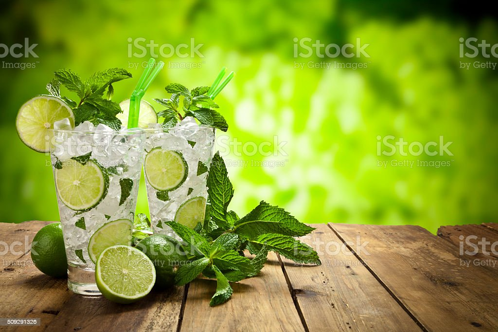 Two mojito cubano drinks on rustic wood table stock photo