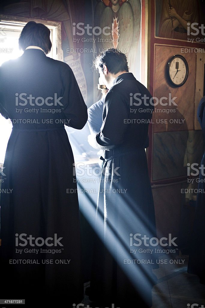 Two monk eat after the Liturgy near window royalty-free stock photo