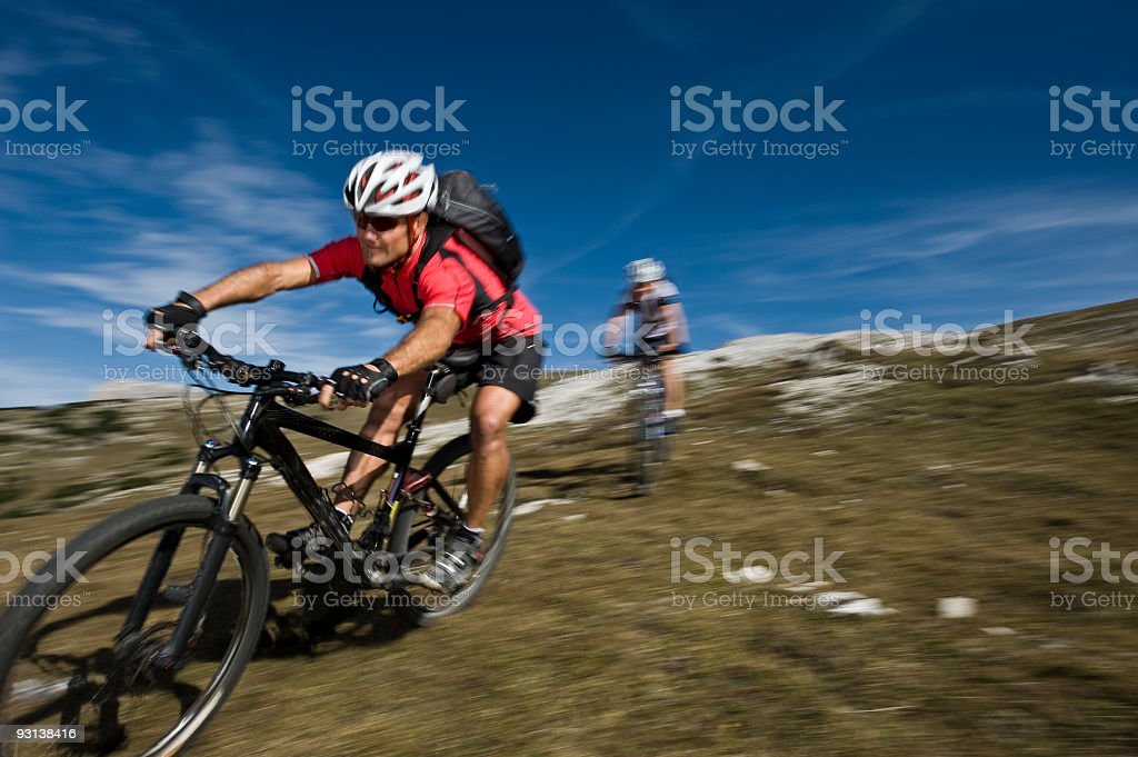 Two Mountain Biker with Blurred Background royalty-free stock photo