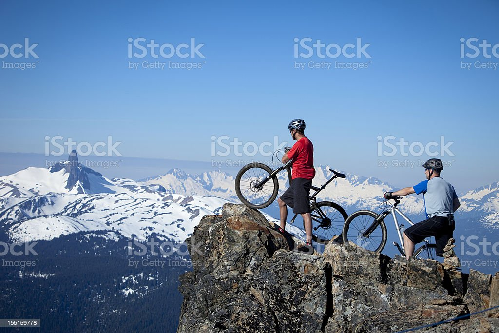 two mountain bikers at top of the world royalty-free stock photo