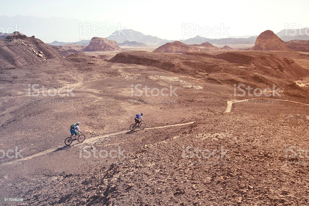 two mountain bikers in the desert stock photo