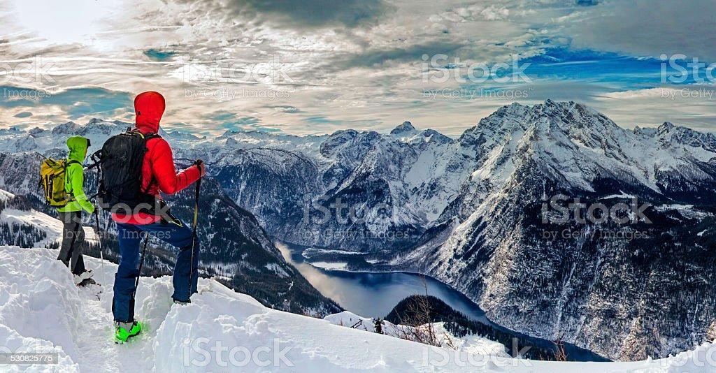 Two mountain climber look to Watzmann in Winter stock photo