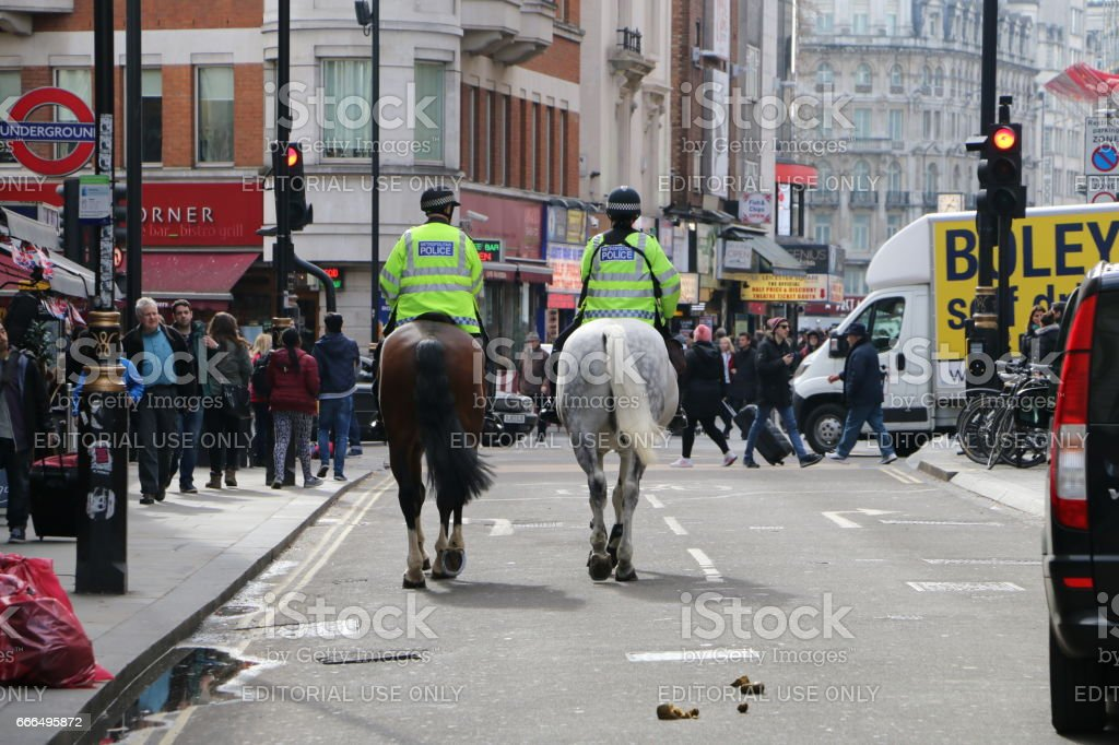 Two mounted police officer patrol stock photo