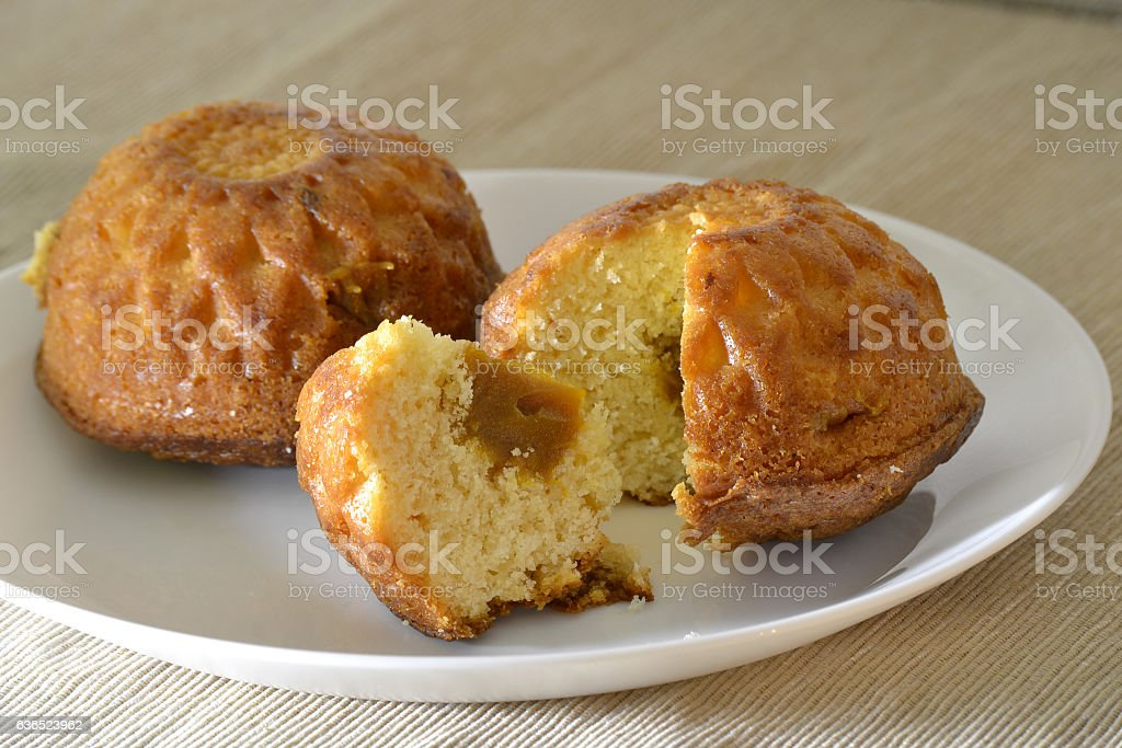 Two muffin on a white plate with a stuffing stock photo
