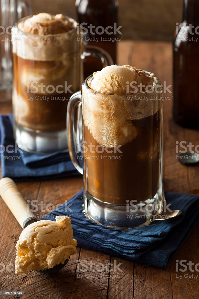Two mugs of refreshing root beer float served with ice cream stock photo