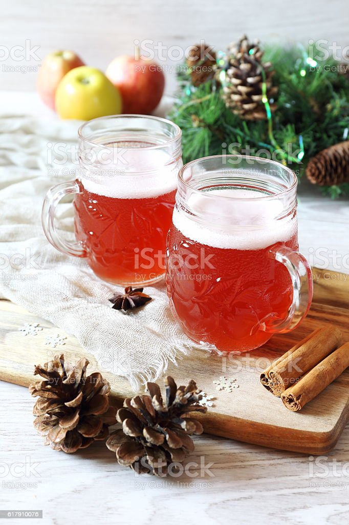 Two mugs of winter craft beer with foam cap stock photo