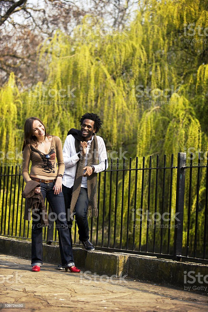Two multicultural adults in a park scene. royalty-free stock photo